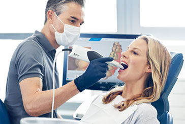 Image of a dental scanner being used on a patient